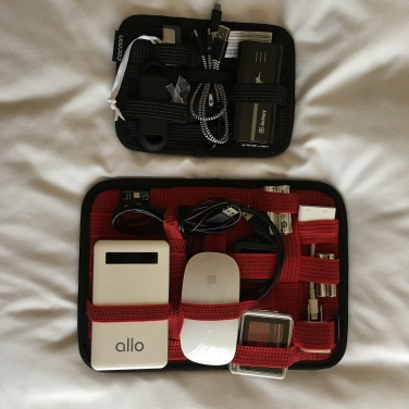 I always travel with my Grid-It Cocoons. Best organizers when you carry lots of electronics.